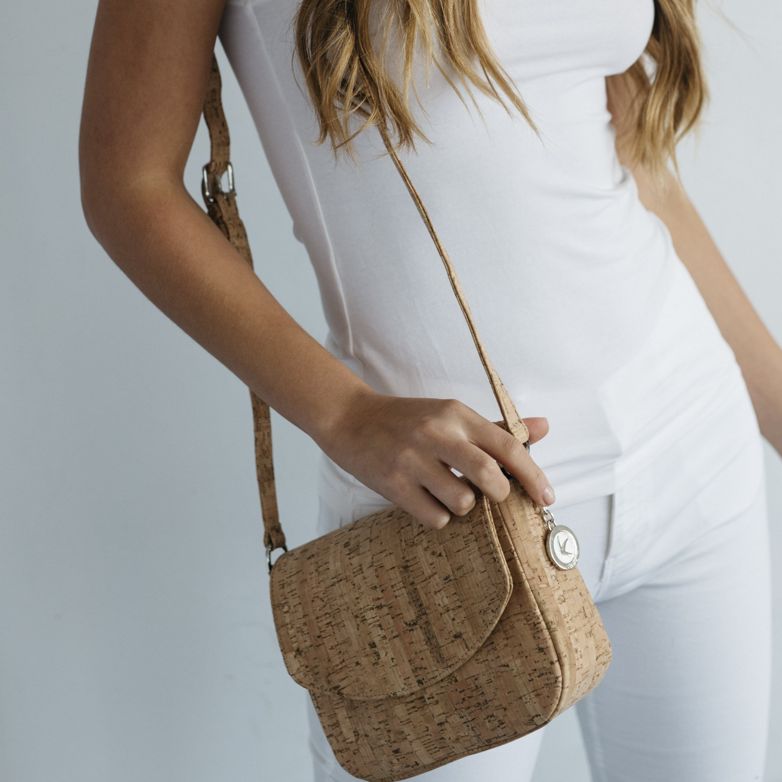 Svala - natural cork crossbody with model.jpg 55ac8c185964